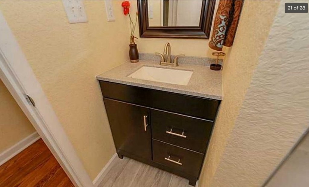 Shown above is an expensive kitchen remodel in a 1961 brick ranch in Portsmouth, Virginia, and it's in foreclosure. The original kitchen is sitting in a landfill somewhere, as are the plaster walls and studs that defined the kitchen, dining room and living room.